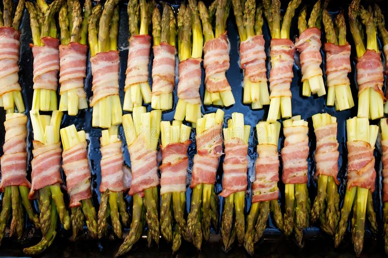Grilled green asparagus wrapped with bacon royalty free stock photos