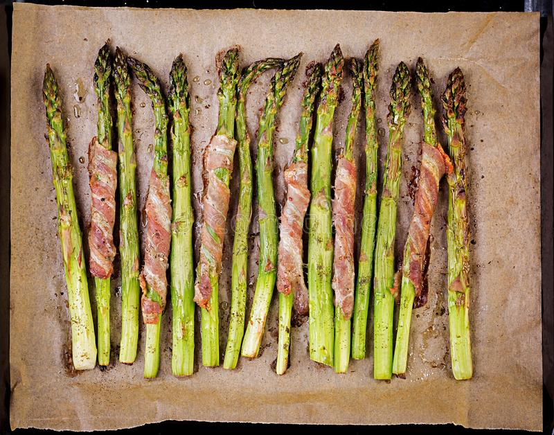 Grilled green asparagus wrapped with bacon stock photography