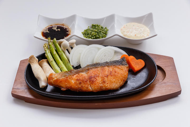 Grilled Japanese Salmon Steak with Mushroom, Asparagus, Sliced Onion and Carrot with Soy Sauce. Scallion Sauce and Mayonnaise.  royalty free stock photos