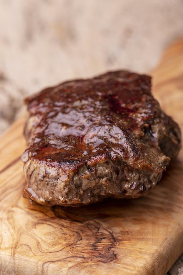 Grilled juicy steak stock image