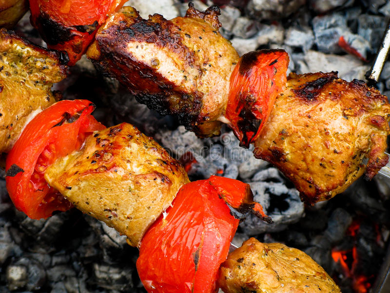 Grilled kebab and tomato stock photography