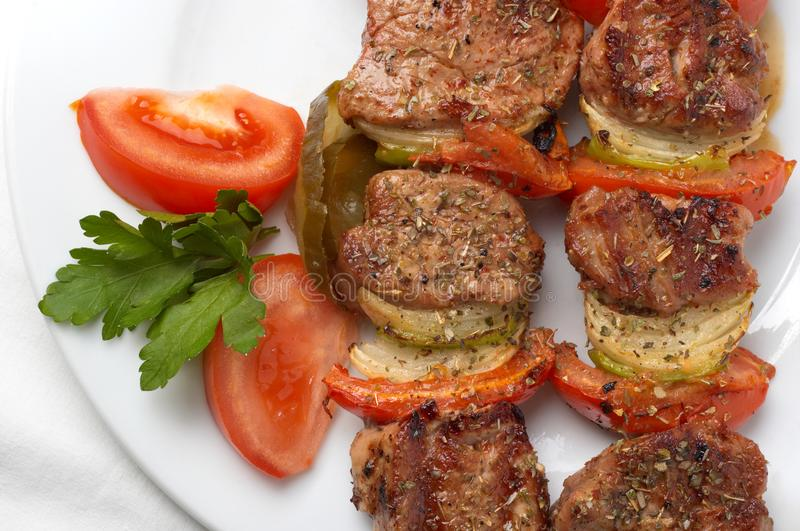 Grilled kebab with vegetables royalty free stock image