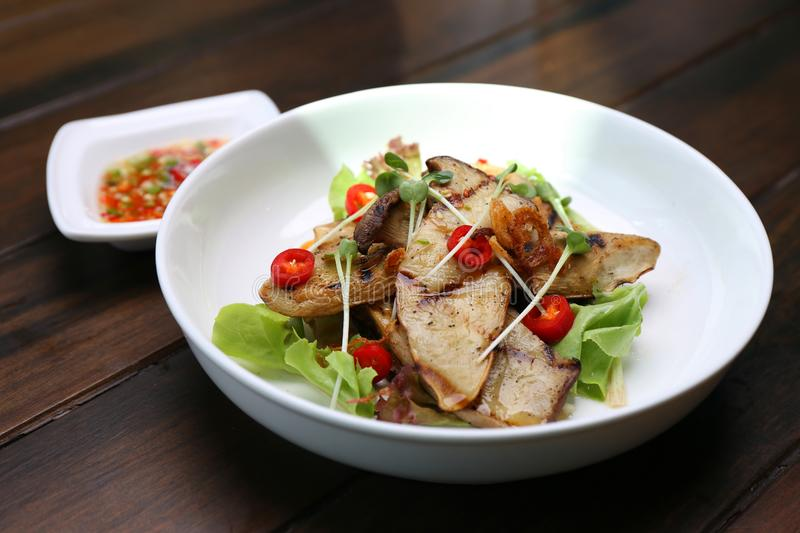 Grilled King Oyster Mushroom , Eryngii slices with sunflower sprout and green oak lettuce on white plate royalty free stock image