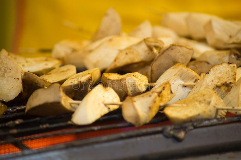 Grilled king oyster mushroom selling on night market., Thailand famous street food. Grilled king oyster mushroom selling on night market., Thailand street food royalty free stock images