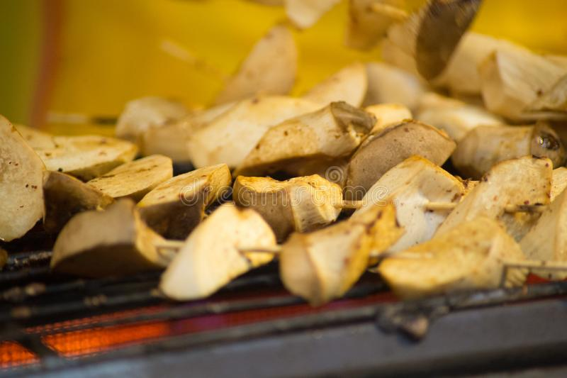 Grilled king oyster mushroom selling on night market., Thailand famous street food. Grilled king oyster mushroom selling on night market., Thailand street food stock photo