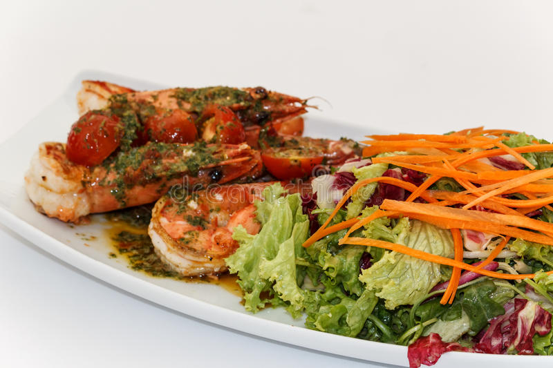 Grilled King Prawns with salad stock photos