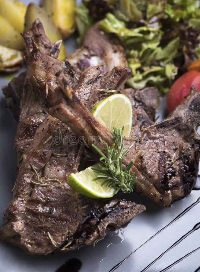 Grilled lamb chops with baked potatoes 1 stock photography