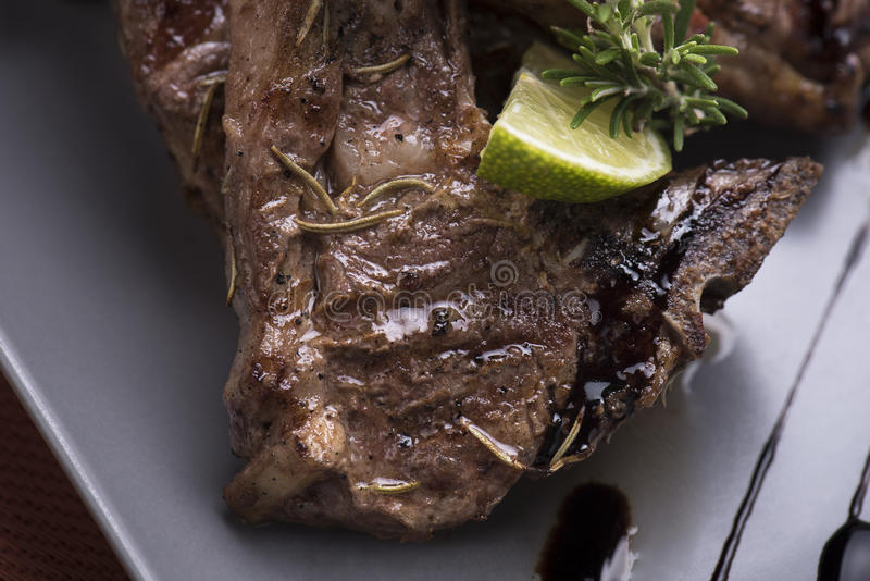 Grilled lamb chops with baked potatoes 6close up shot royalty free stock image