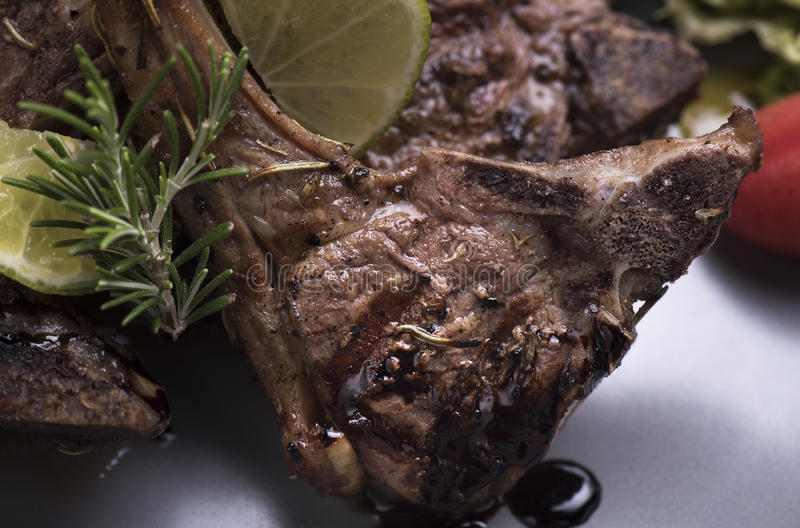 Grilled lamb chops with baked potatoes 8close up shot stock photos