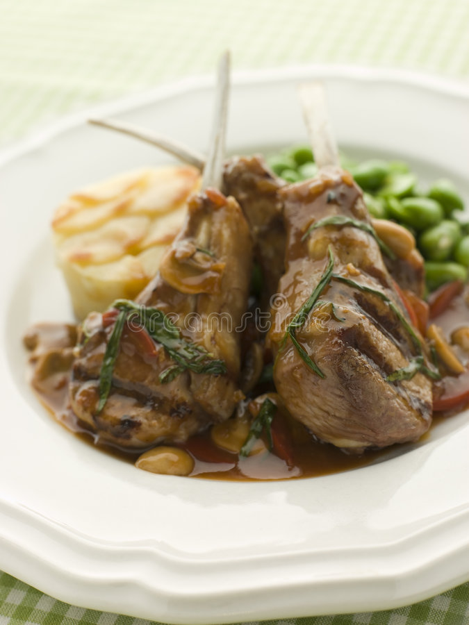 Free Grilled Lamb Cutlets Chasseur Sauce Pomme Anna Stock Photo - 5624020