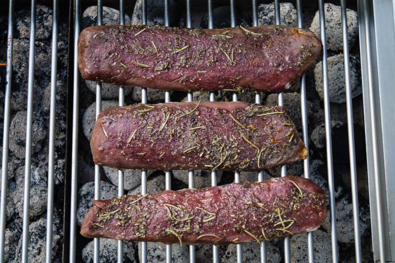 Grilled lamb steaks stock photos