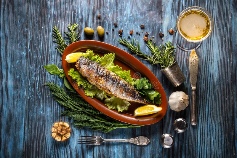 Grilled mackerel fillets with lemon on rustic background royalty free stock image