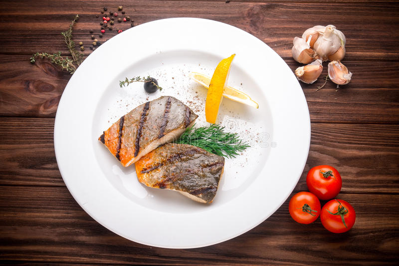Grilled mackerel fish with vegetables royalty free stock images