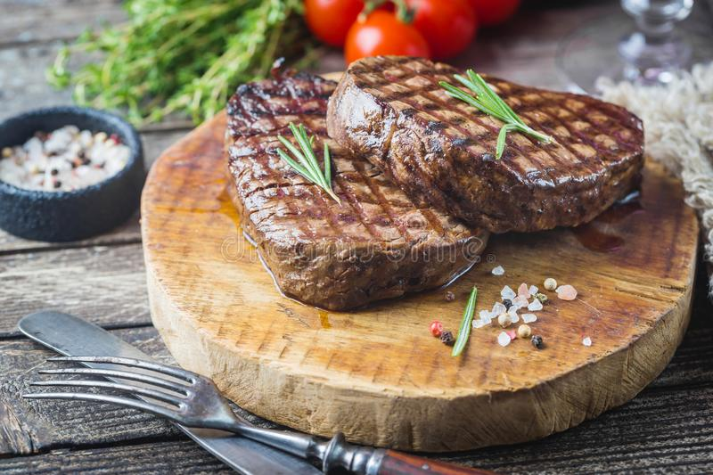 Grilled marbled meat steak. Filet Mignon with seasonings. Juicy beef steak on cutting board stock photo