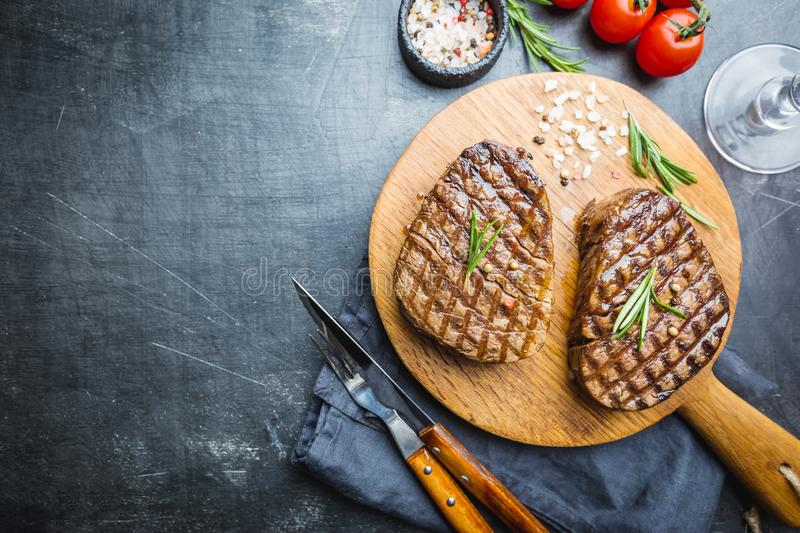 Grilled marbled meat steak. Filet Mignon with seasonings. Juicy beef steak on cutting board, top view stock photo
