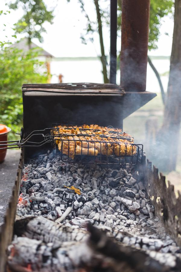 Grilled marinated chicken on a metal grid.  stock photography