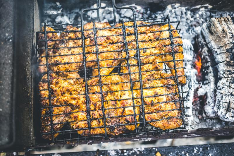 Grilled marinated chicken on a metal grid.  stock photos