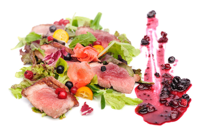 Grilled meat with cranberry and blackcurrant sauce royalty free stock images