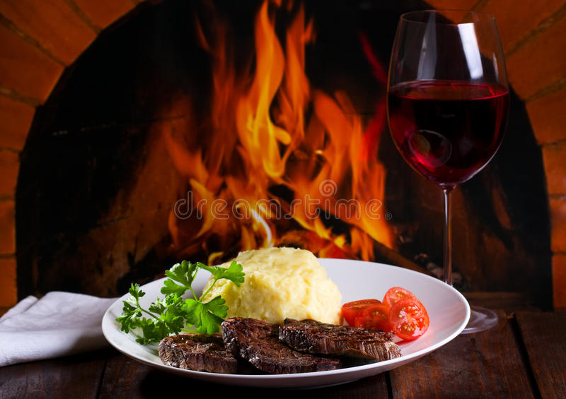 Grilled meat and glass of wine royalty free stock photo