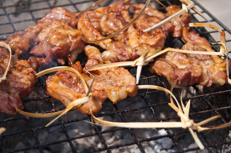 Grilled meat on the grating royalty free stock photo