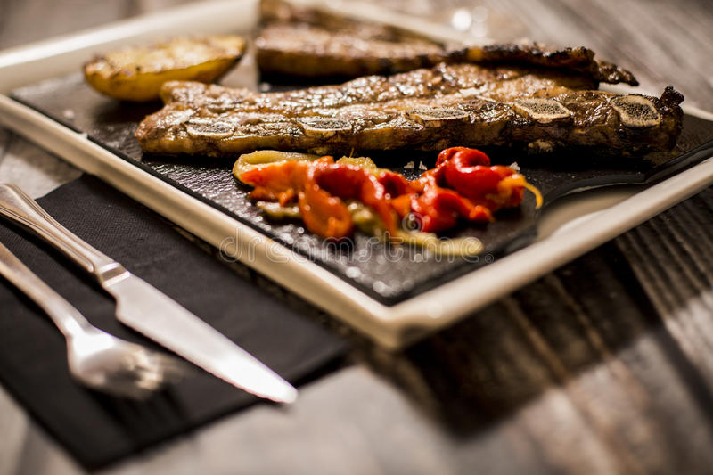 Grilled meat with grilled vegetables stock photography