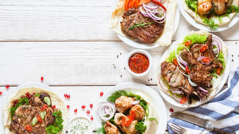 Grilled meat meals food table barbecue table dish stock photo