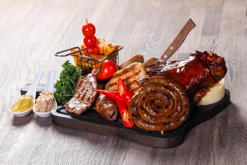 Grilled meat mix plate royalty free stock image