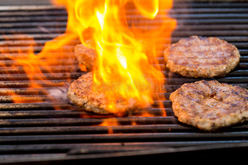Grilled meat / pork burgers, grill, smoke and light aroma - Cook. Ing grill burgers process royalty free stock photos