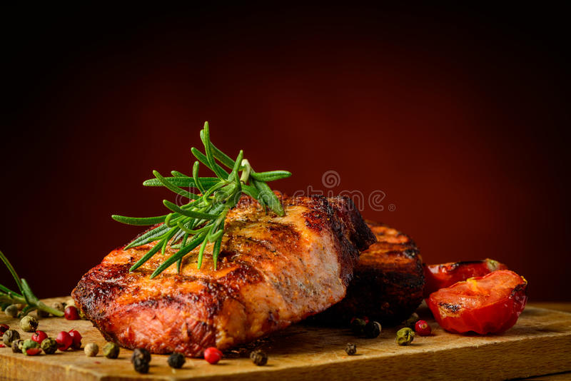 Grilled meat and rosemary royalty free stock photos