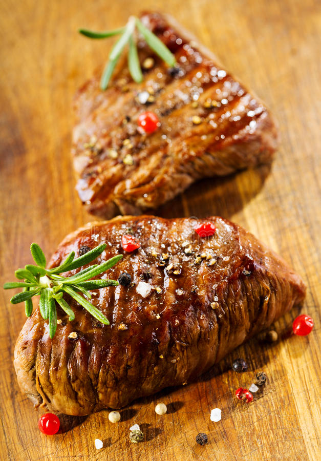 Grilled meat with rosemary stock photography