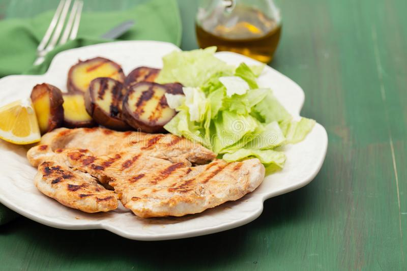 Grilled meat with salad and sweet potato royalty free stock photos