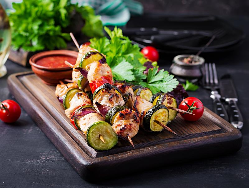 Grilled meat skewers, chicken shish kebab with zucchini, tomatoes and red onions. Grilled meat skewers, chicken  shish kebab with zucchini, tomatoes and red stock images