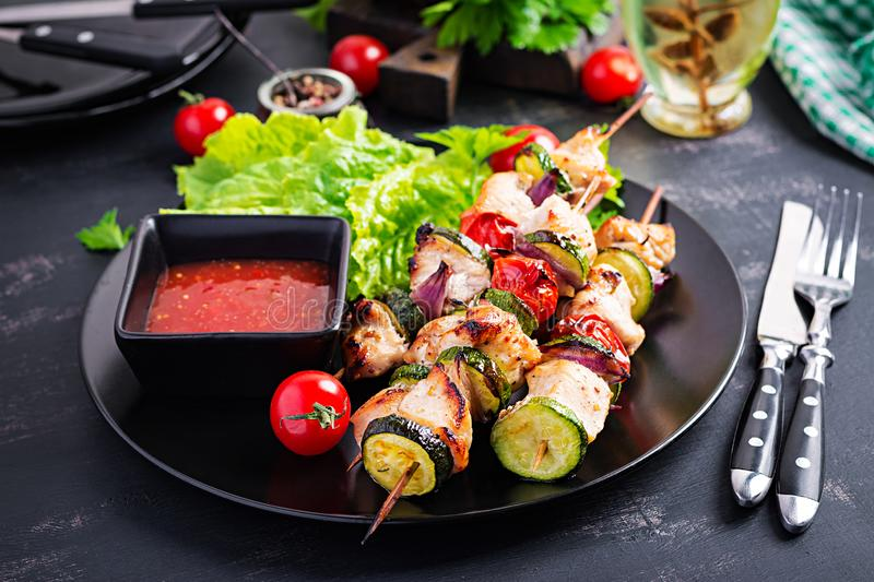 Grilled meat skewers, chicken shish kebab with zucchini, tomatoes and red onions. Grilled meat skewers, chicken  shish kebab with zucchini, tomatoes and red royalty free stock photos