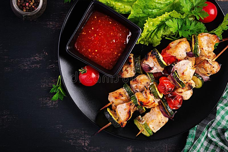 Grilled meat skewers, chicken shish kebab with zucchini, tomatoes and red onions. Grilled meat skewers, chicken  shish kebab with zucchini, tomatoes and red stock photo