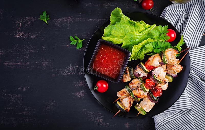 Grilled meat skewers, chicken shish kebab with zucchini, tomatoes and red onions. Grilled meat skewers, chicken  shish kebab with zucchini, tomatoes and red royalty free stock photo