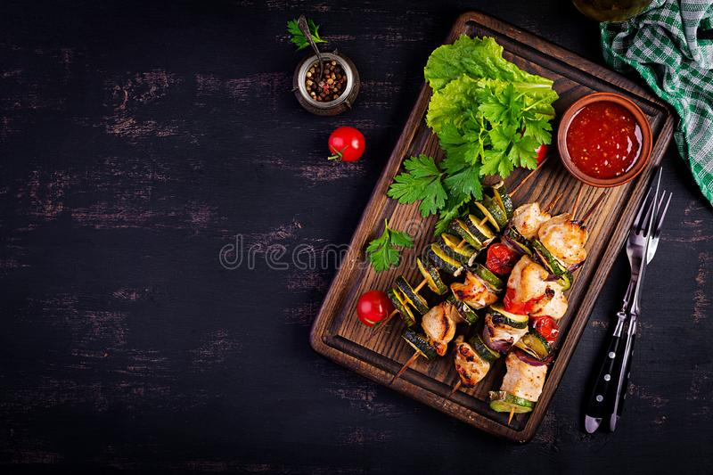 Grilled meat skewers, chicken shish kebab with zucchini, tomatoes and red onions. Grilled meat skewers, chicken  shish kebab with zucchini, tomatoes and red stock image