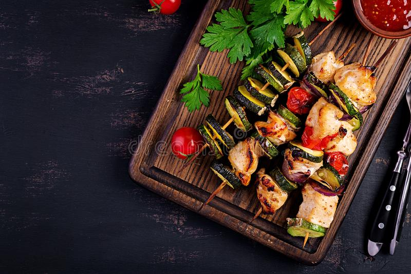 Grilled meat skewers, chicken shish kebab with zucchini, tomatoes and red onions. Grilled meat skewers, chicken  shish kebab with zucchini, tomatoes and red stock photography
