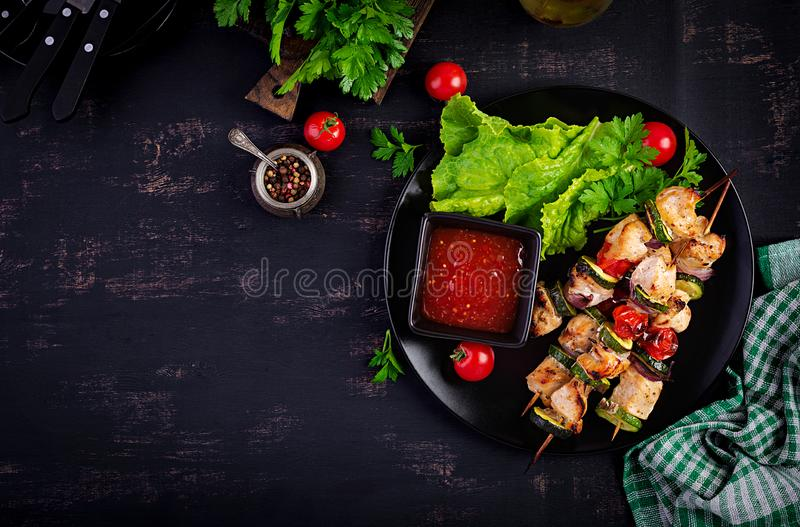 Grilled meat skewers, chicken shish kebab with zucchini, tomatoes and red onions. Grilled meat skewers, chicken  shish kebab with zucchini, tomatoes and red stock photos