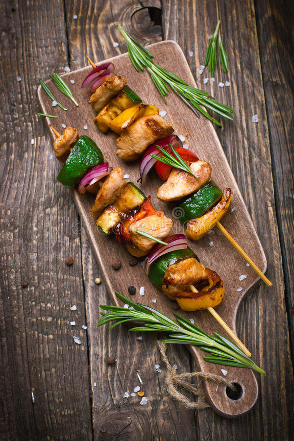 Grilled meat and vegetable kebabs royalty free stock photo