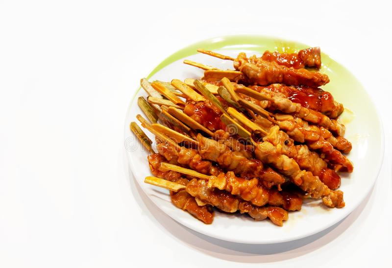 Grilled meat on white background, pork skewers served on a plate. Appetizer royalty free stock images