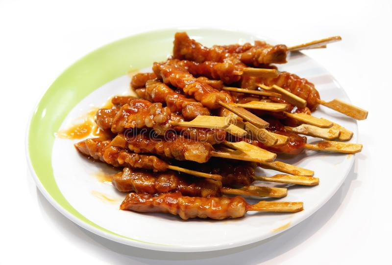 Grilled meat on white background, pork skewers served on a plate. Appetizer royalty free stock photo