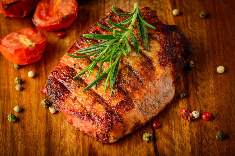 Grilled meat on wooden plate royalty free stock photo