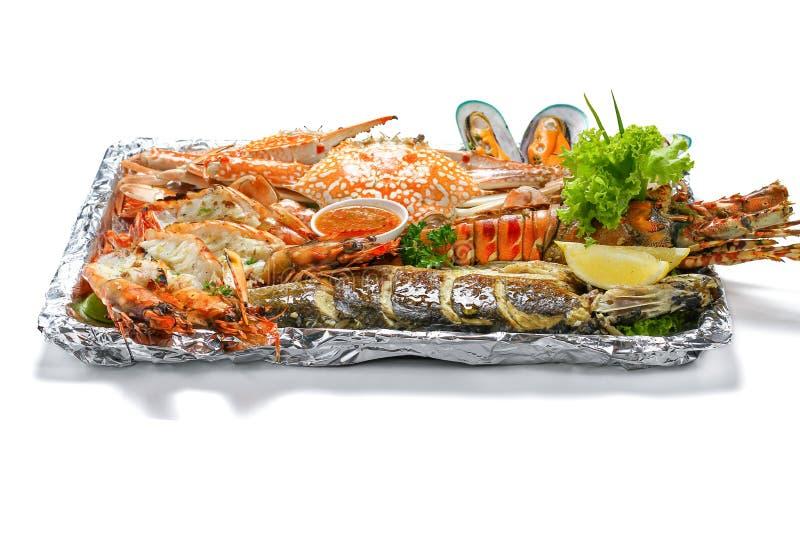 Grilled Mixed Sea-food Big Set contain Lobster Sea Perch Fish Blue Clab Big Shrimps Mussel Clams Calamari Squids stock photo