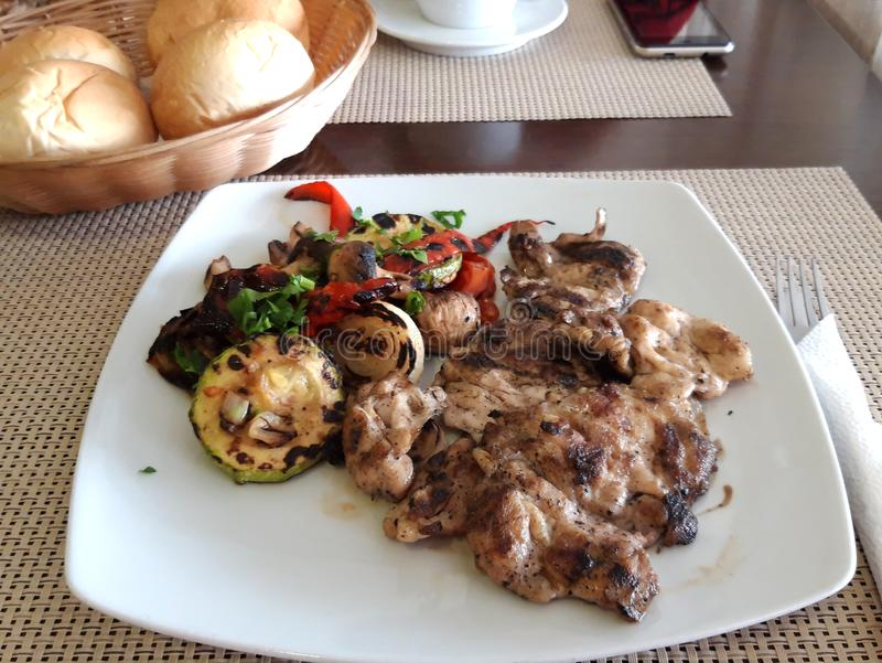 Grilled mixed vegetables and Grilled Chicken Thighs stock image