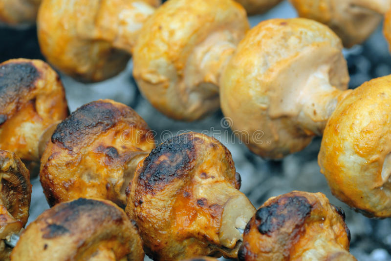 Grilled mushrooms. Closeup grilled mushrooms in mayonnaise royalty free stock images