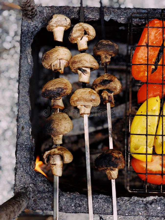 Grilled Mushrooms on Charcoal Grill royalty free stock photography