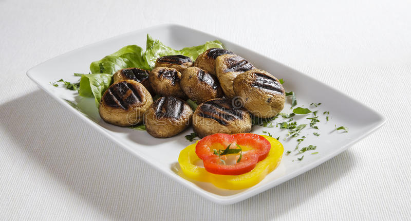 Grilled mushrooms stock photos