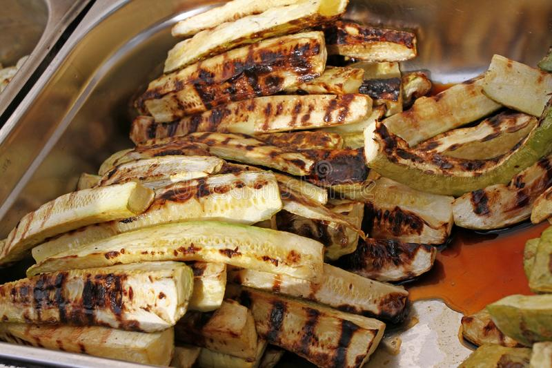 Grilled organic zucchini on a bbq. Vegetables on Barbeque wallpaper. Vegetable background texture. Grilled green zucchini. Grilled royalty free stock photography