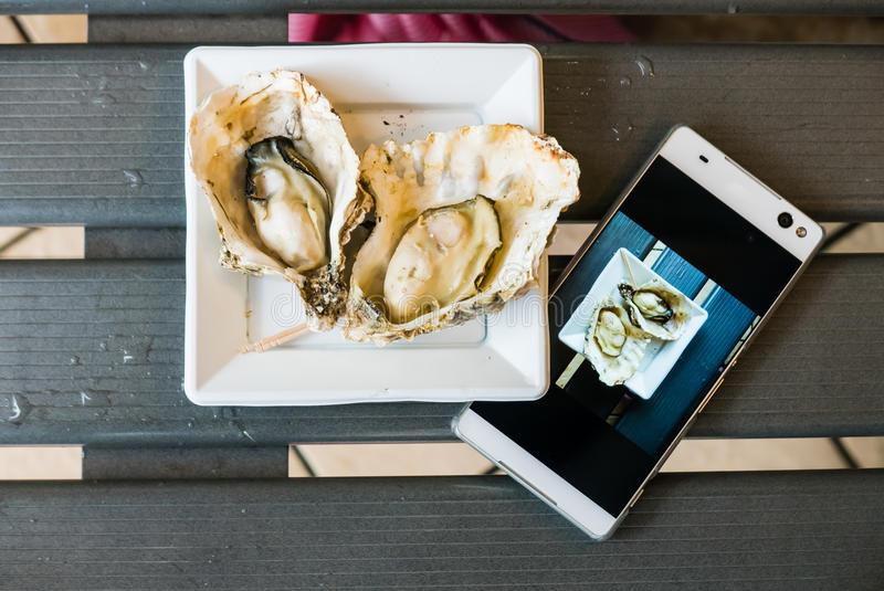 Grilled Oyster in Miyajima island. Miyajima island is a famous island shrine-town is a UNESCO World Heritage Site and a major tourism destination royalty free stock image