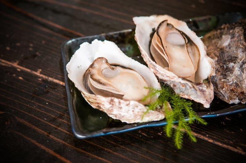 Grilled oysters - Miyajima famous dish - Hiroshima - Japan. Fresh grilled oysters - Miyajima famous dish - Hiroshima - Japan stock photo